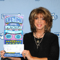 The woman became a lifetime lottery winner in Massachusetts Lottery